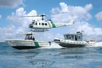 Office_of_CBP_Air_and_Marine_helicopter_and_boats.jpg